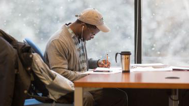 A student studies at Tuck's Feldberg Library